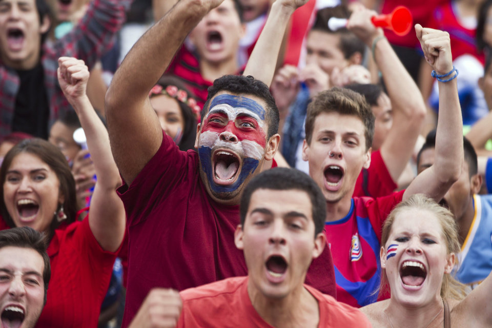 Photo - Costa Rica soccer fans celebrate their team's victory over Greece at a Brazil World Cup round of 16 game in San Jose, Costa Rica, Sunday, June 29, 2014. Costa Rica won a penalty shootout 5-3 after the match ended 1-1 following extra time. (AP Photo/Esteban Felix)