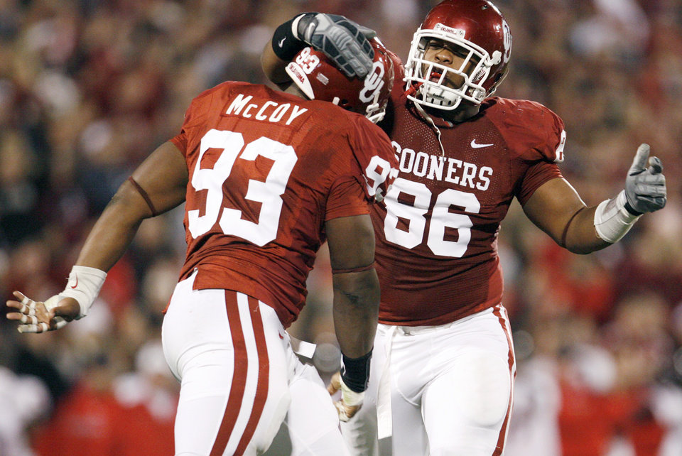 OU\'s Gerald McCoy (93) and Adrian Taylor (86) celebrate a stop of the Texas Tech offense on third down in the second quarter of the college football game between the University of Oklahoma Sooners and Texas Tech University at Gaylord Family -- Oklahoma Memorial Stadium in Norman, Okla., Saturday, Nov. 22, 2008. BY NATE BILLINGS, THE OKLAHOMAN