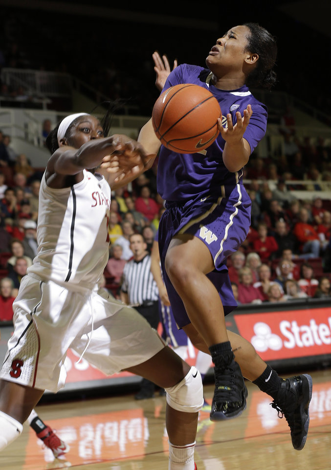 Photo - Washington guard Jazmine Davis, right, has the ball stripped by Stanford forward Chiney Ogwumike during the first half of an NCAA college basketball game on Thursday, Feb. 27, 2014, in Stanford, Calif. (AP Photo/Marcio Jose Sanchez)