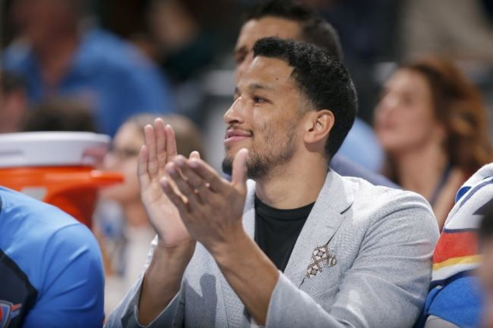 Photo -  Oklahoma City's Andre Roberson cheers from the bench during a game at Chesapeake Energy Arena. Roberson missed the entire 2018-19 season with an injury. [Sarah Phipps/The Oklahoman]