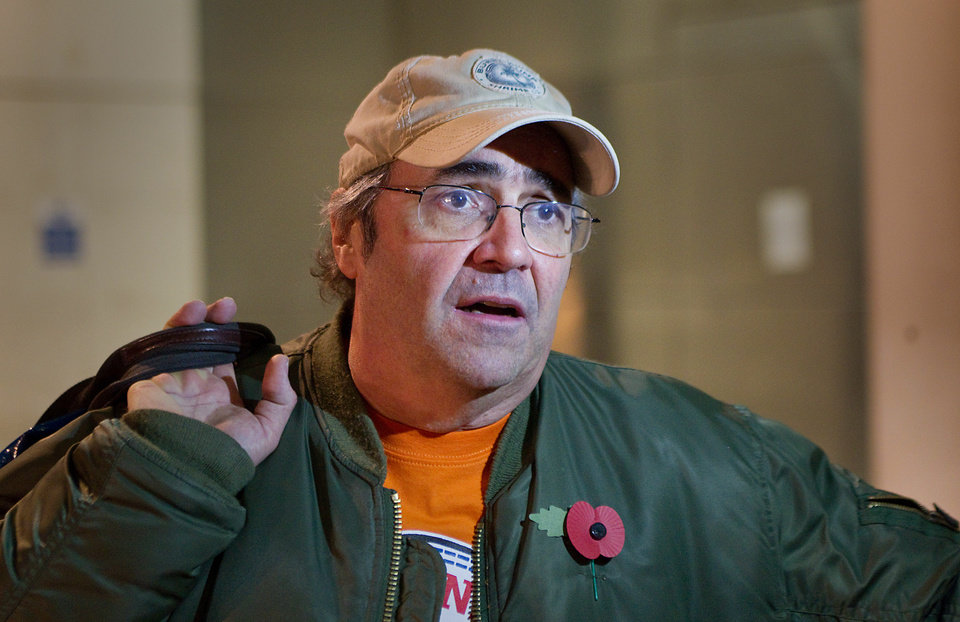 Photo -   In this photo taken Thursday, Nov. 1, 2012, British DJ Danny Baker speaks to the media outside the British Broadcasting Corporation's (BBC) Broadcasting House after announcing that his show on BBC London radio had been canceled, London. Baker opened his afternoon slot on BBC London radio Thursday by announcing that the show had been canceled. The BBC confirmed Baker was due to leave at the end of the year, but could not say whether he would complete his contract. (AP Photo/PA, Philip Toscano) UNITED KINGDOM OUT, NO SALES, NO ARCHIVE