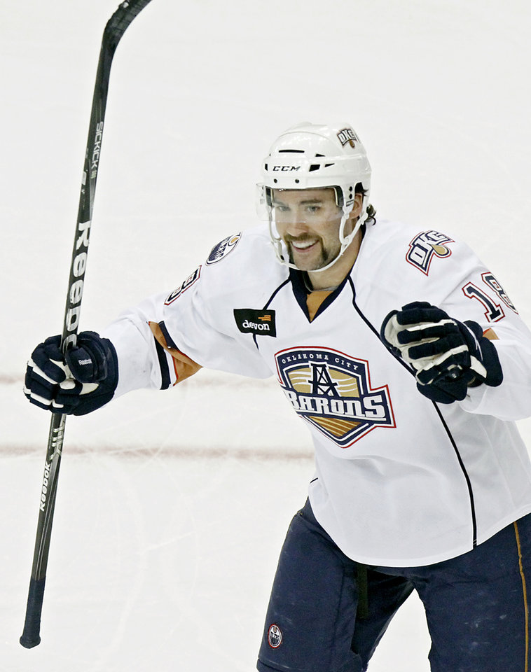 OKLAHOMA CITY BARONS: Oklahoma City\'s Colin McDonald celebrates after scoring the Barons\' first goal against Milwaukee during their AHL hockey game at the Cox Convention Center in Oklahoma City on Sunday, Nov. 21, 2010. Photo by John Clanton, The Oklahoman ORG XMIT: KOD