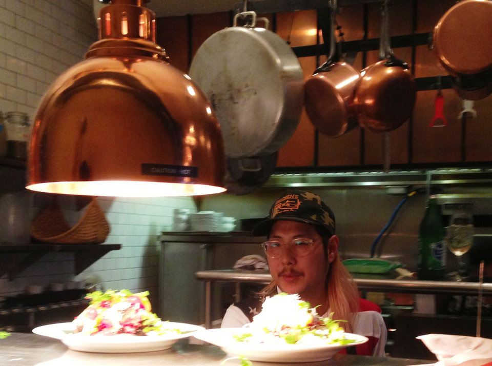 Chef Danny Bowien expdidtes dishes at Ludivine on Monday. <strong>DAVE CATHEY - THE OKLAHOMAN</strong>