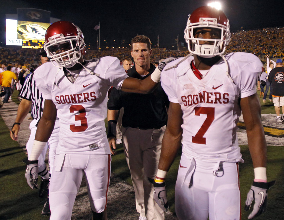 Photo - Oklahoma's Jonathan Nelson (3) and DeMarco Murray (7) walk off the field after the college football game between the University of Oklahoma Sooners (OU) and the University of Missouri Tigers (MU) on Saturday, Oct. 23, 2010, in Columbia, Mo. Oklahoma lost the game 36-27. Photo by Chris Landsberger, The Oklahoman