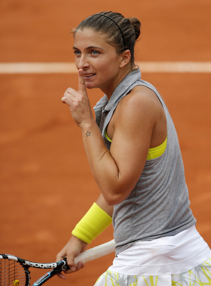 Photo - Italy's Sara Errani has her finger on her mouth after defeating Serbia's Jelena Jankovic during their fourth round match of  the French Open tennis tournament at the Roland Garros stadium, in Paris, France, Monday, June 2, 2014. (AP Photo/David Vincent)