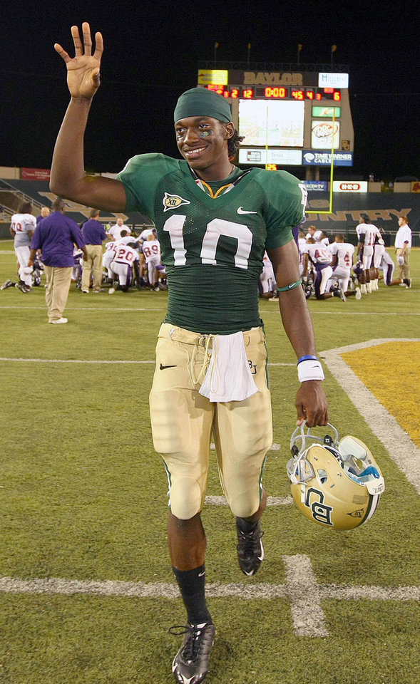 Photo - Baylor University quarterback Robert Griffin raises his hand while walking off the field after an NCAA college football game against Northwestern State University on Saturday Sept. 6, 2008 in Waco, Texas. Baylor defeated Northwestern State 51-6.  (AP Photo/Waco Tribune Herald, Jerry Larson) ORG XMIT: TXWAC107