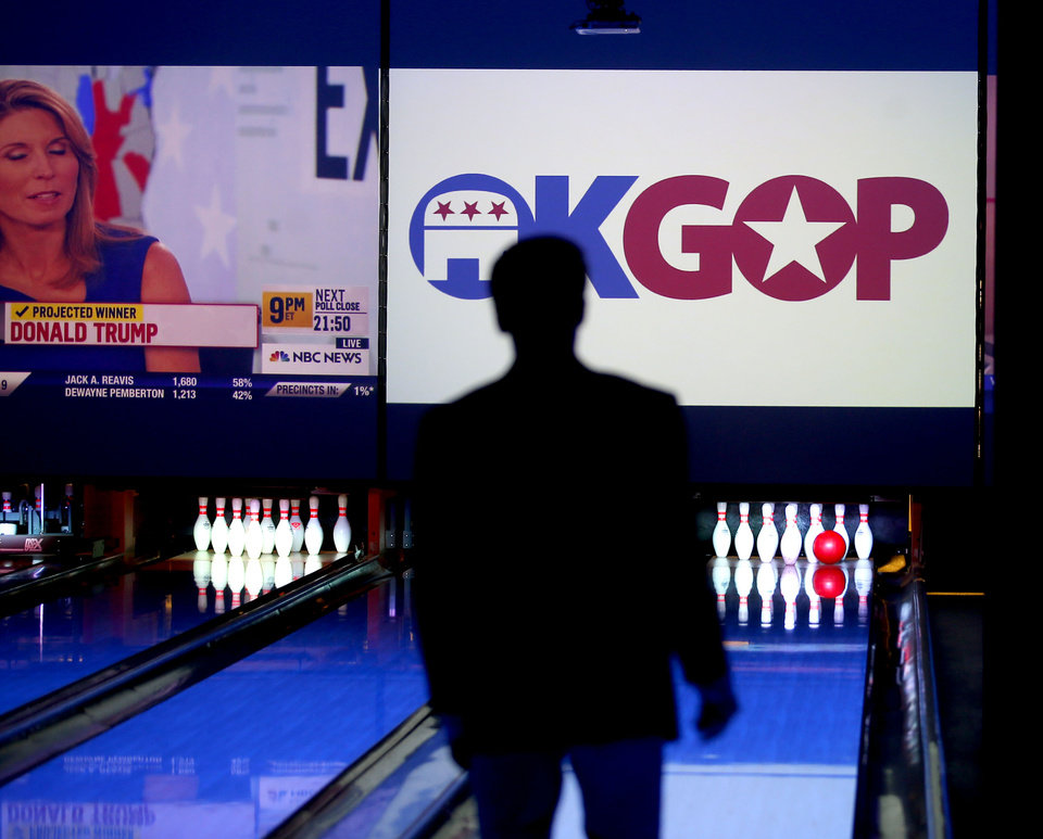Photo - A person bowls as Republican Party backers gathered Tuesday night at Main Event Entertainment in northwest Oklahoma City as election returns rolled in the presidential race against Donald Trump and Democrat Hillary Clinton. Oklahomans on Tuesday also cast votes on several state ballot measures, a host of legislative contests and other local issues and offices. Photo by Bryan Terry, The Oklahoman