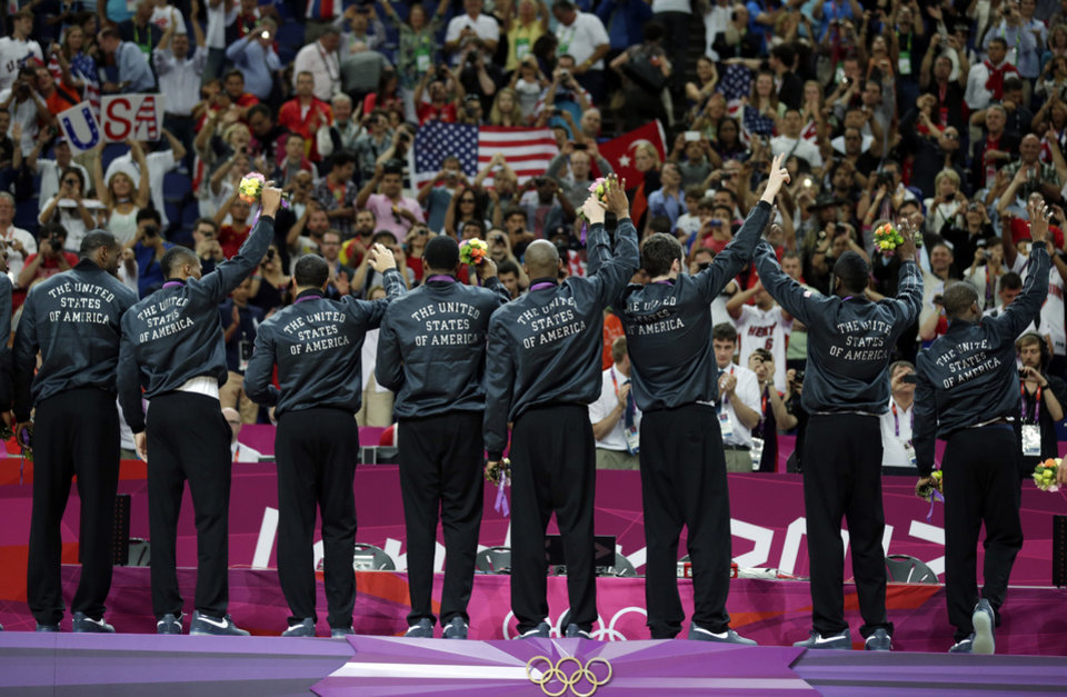 Members of the United States' men's basketball team celebrate after winning the gold medal against Spain at the 2012 Summer Olympics, Sunday, Aug. 12, 2012, in London. (AP Photo/Charles Krupa)