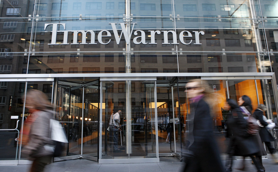 Photo - FILE - In this Nov. 7, 2007 file photo, people walk by the Time Warner Center in New York. Time Warner Inc. on Wednesday, July 16, 2014 said it has rejected a takeover bid from Twenty-First Century Fox and says it has no interest in further discussions with Rupert Murdoch's media entertainment giant. (AP Photo/Diane Bondareff, File)