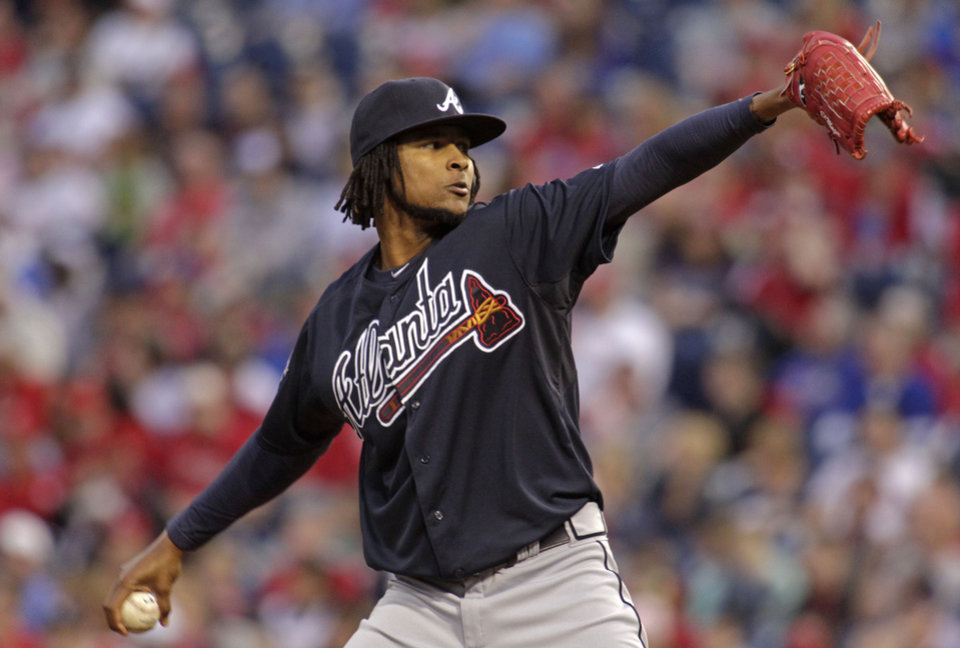 Photo - Atlanta Braves starting pitcher Ervin Santana throws against the Philadelphia Phillies in the first inning of the MLB National League baseball game Monday, April 14, 2014, in Philadelphia. (AP Photo/H. Rumph Jr)
