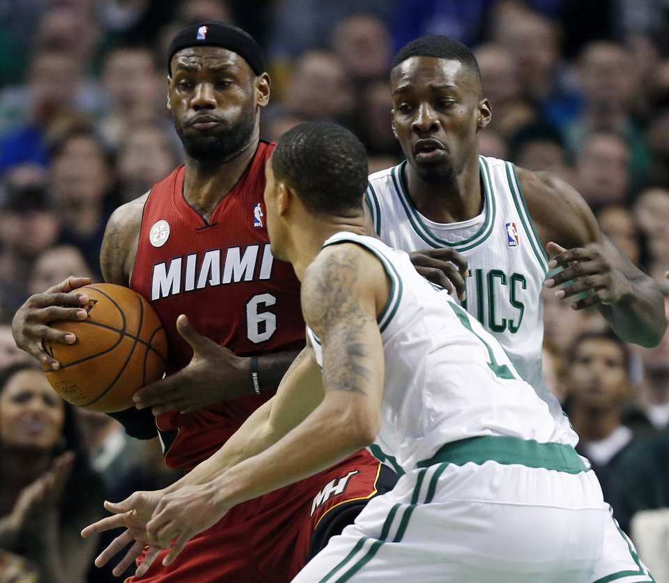 Photo - Boston Celtics' Jeff Green, right, and Courtney Lee, front, double-team Miami Heat's LeBron James (6) in the first quarter of an NBA basketball game in Boston, Monday, March 18, 2013. (AP Photo/Michael Dwyer)