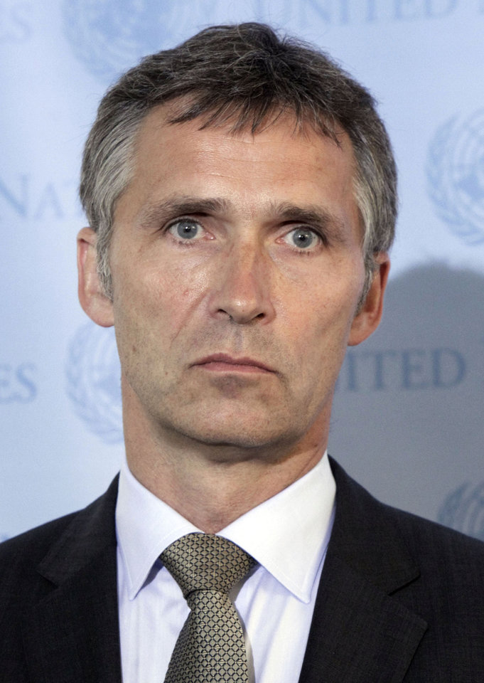 Photo - FILE -- Norway's Prime Minister Jens Stoltenberg poses at the United Nations in New York, in this Tuesday, July 13, 2010 file photo. Stoltenberg was reportedly safe after a blast outside his office in Oslo, Friday July 22, 2011.The centre of the explosion was apparently between his his office and the oil and energy ministry, which were both badly damaged in the explosion.(AP Photo/Richard Drew) ORG XMIT: LON110