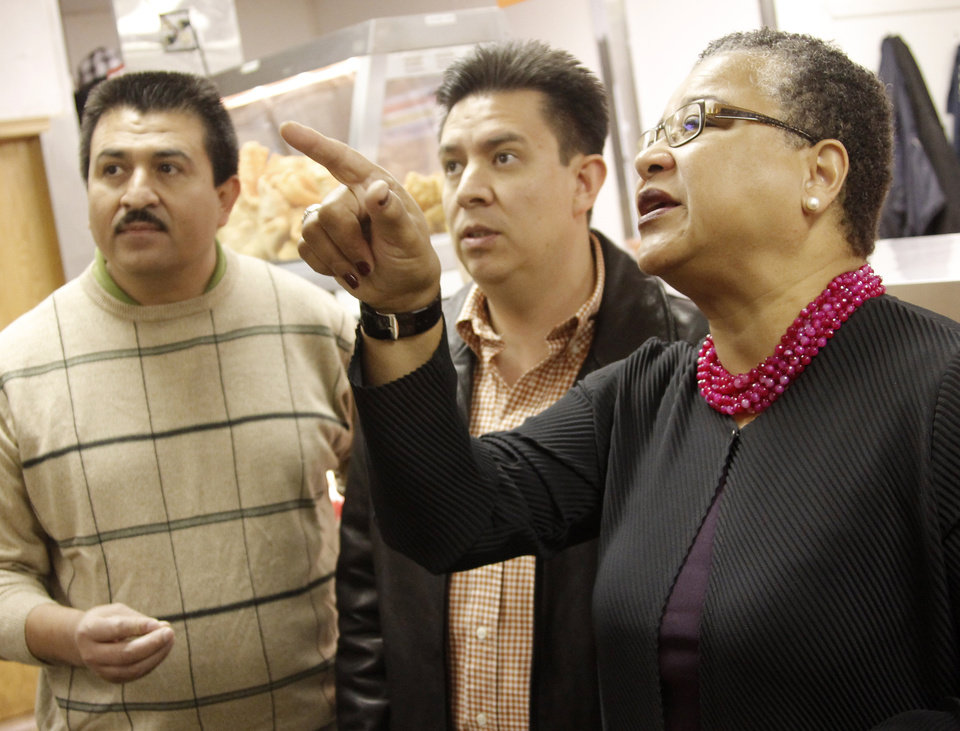 Francisco Ibarra, CEO, left, and Tulsa manager Manuel Gomez talk about spices with Small Business Administration Deputy Administrator Marie Johns while touring Supermercados Morelos in Oklahoma City, November 30, 2011. Photo by Doug Hoke, The Oklahoman