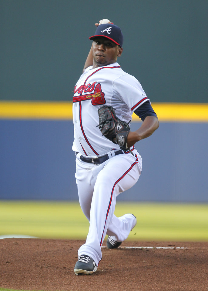 Photo - Atlanta Braves starting pitcher Julio Teheran delivers in the first inning of a baseball game against the Philadelphia Phillies Monday, June 16, 2014, in Atlanta. (AP Photo/Todd Kirkland)