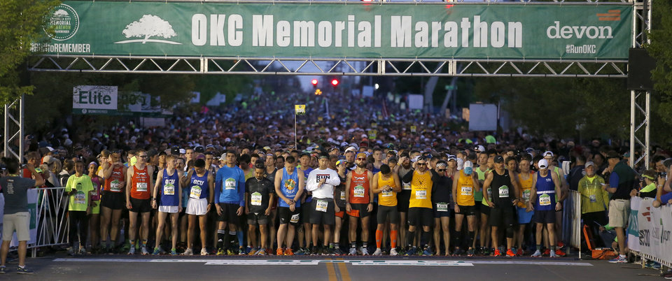 Photo - Runners wait to start the Oklahoma City Marathon in Oklahoma City,  Sunday, April 29, 2018. Photo by Sarah Phipps, The Oklahoman