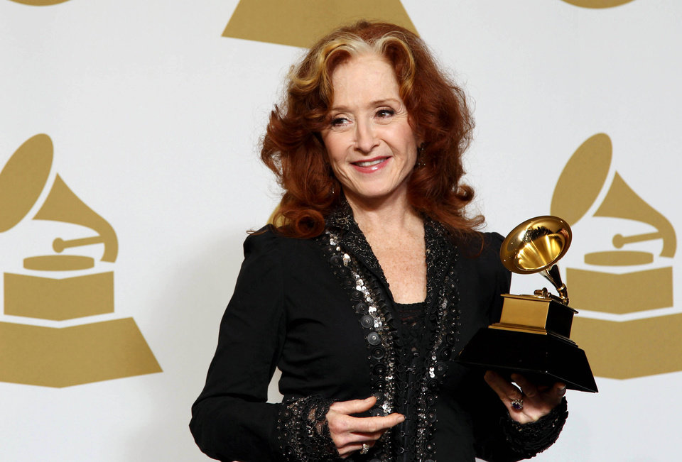 Photo - Bonnie Raitt poses backstage with the award for best americana album for