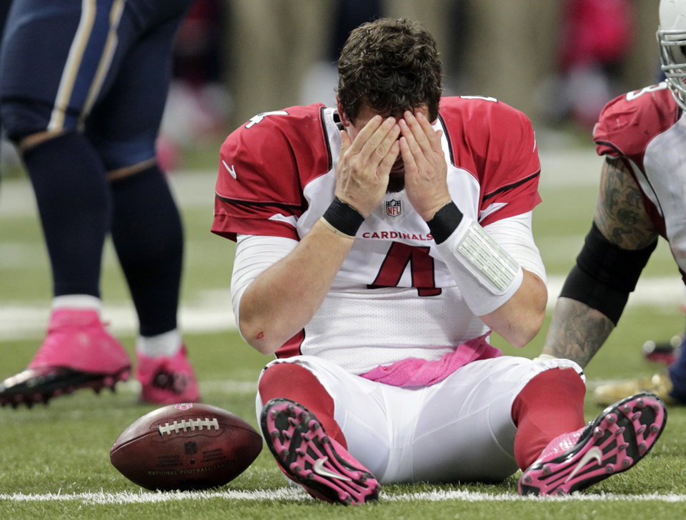 FILE - This Oct. 4, 2012 file photo shows Arizona Cardinals quarterback Kevin Kolb reacting after being sacked during the third quarter of an NFL football game against the St. Louis Rams, in St. Louis. Kolb was sacked 17 times and hit many more in the last two games. (AP Photo/Tom Gannam, File)