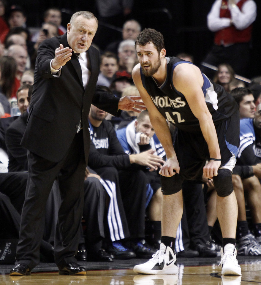 FILE - In this March 3, 2012, file photo, Minnesota Timberwolves coach Rick Adelman, left, talks with forward Kevin Love during the second half of an NBA basketball game against the Portland Trail Blazers in Portland, Ore. Love will miss the next six to eight weeks after breaking his right hand in a workout on Wednesday, Oct. 17, 2012.(AP Photo/Don Ryan, File)
