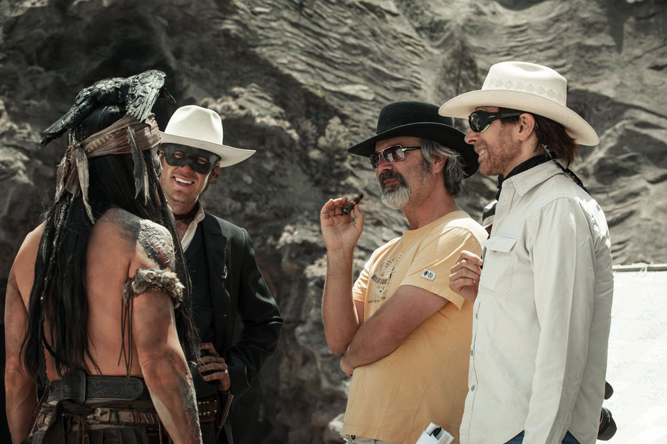 Photo - FILE - This undated publicity photo released by Disney shows, from left, Johnny Depp as Tonto, Armie Hammer as The Lone Ranger, director, Gore Verbinski and producer, Jerry Bruckheimer, on the set of