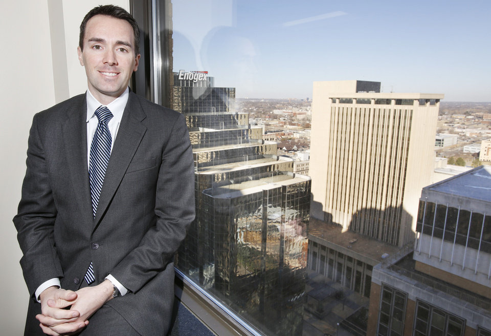 Chris Dunning, senior vice president, is shown with a skyscraper view of downtown Oklahoma City in CB Richard Ellis Capital Markets' new office on the 24th floor of City Place, 204 N Robinson Ave. Photo by Steve Gooch, The Oklahoman