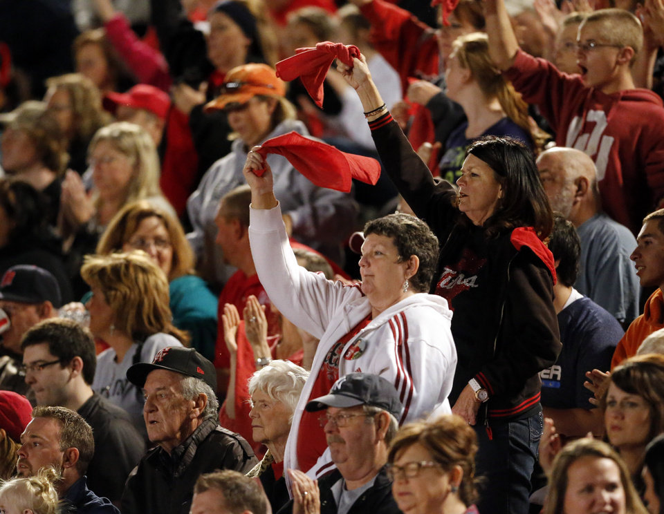 Photo - Carl Albert fans cheer as the Titans play the Del City Eagles in Class 5A, first round, playoff action in high school football on Friday, Nov. 9, 2012 in Del City, Okla.   Photo by Steve Sisney, The Oklahoman