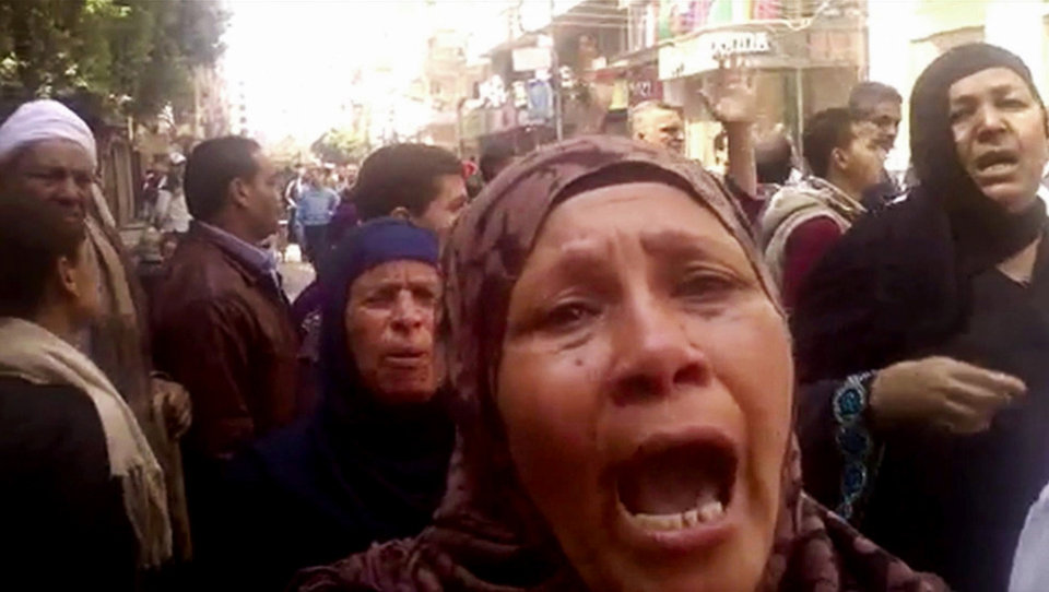 Photo - This image made from video shows relatives reacting after an Egyptian court on Monday sentenced to death 529 supporters of ousted Islamist President Mohammed Morsi in connection to an attack on a police station that killed a senior police officer in Minya, Egypt, Monday, March 24, 2014. The convictions came after after two sessions in a mass trial that raised an outcry from rights activists and threatened to spark a violent backlash.(AP Photo via AP video)