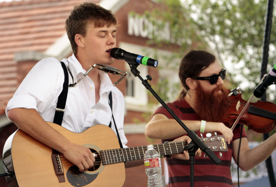 Photo - Parker Millsap, Purcell singer/songwriter, sings and band member Daniel Foulks plays fiddle during the Norman Music Festival on Saturday, April 28, 2012, in Norman, Okla.  Photo by Steve Sisney, The Oklahoman