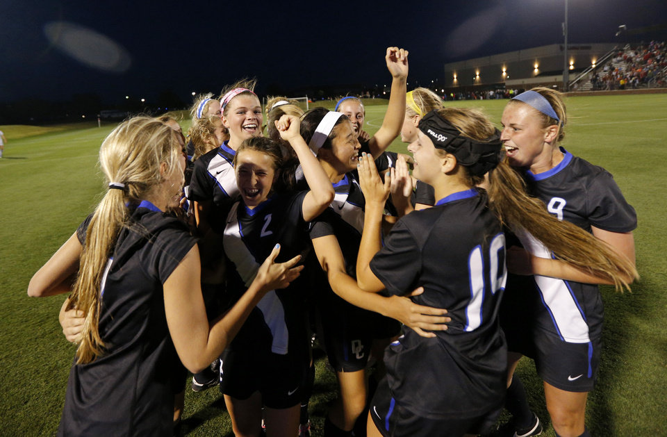 Photo - Deer Creek celebrates after winning the Class 5A girls state soccer championship between Deer Creek and Carl Albert in Norman, Okla., Saturday, May 17, 2014. Photo by Bryan Terry, The Oklahoman