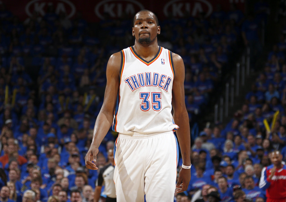 Photo - Oklahoma City's Kevin Durant (35) reacts to a play during Game 1 of the Western Conference semifinals in the NBA playoffs between the Oklahoma City Thunder and the Los Angeles Clippers at Chesapeake Energy Arena in Oklahoma City, Monday, May 5, 2014. Photo by Sarah Phipps, The Oklahoman