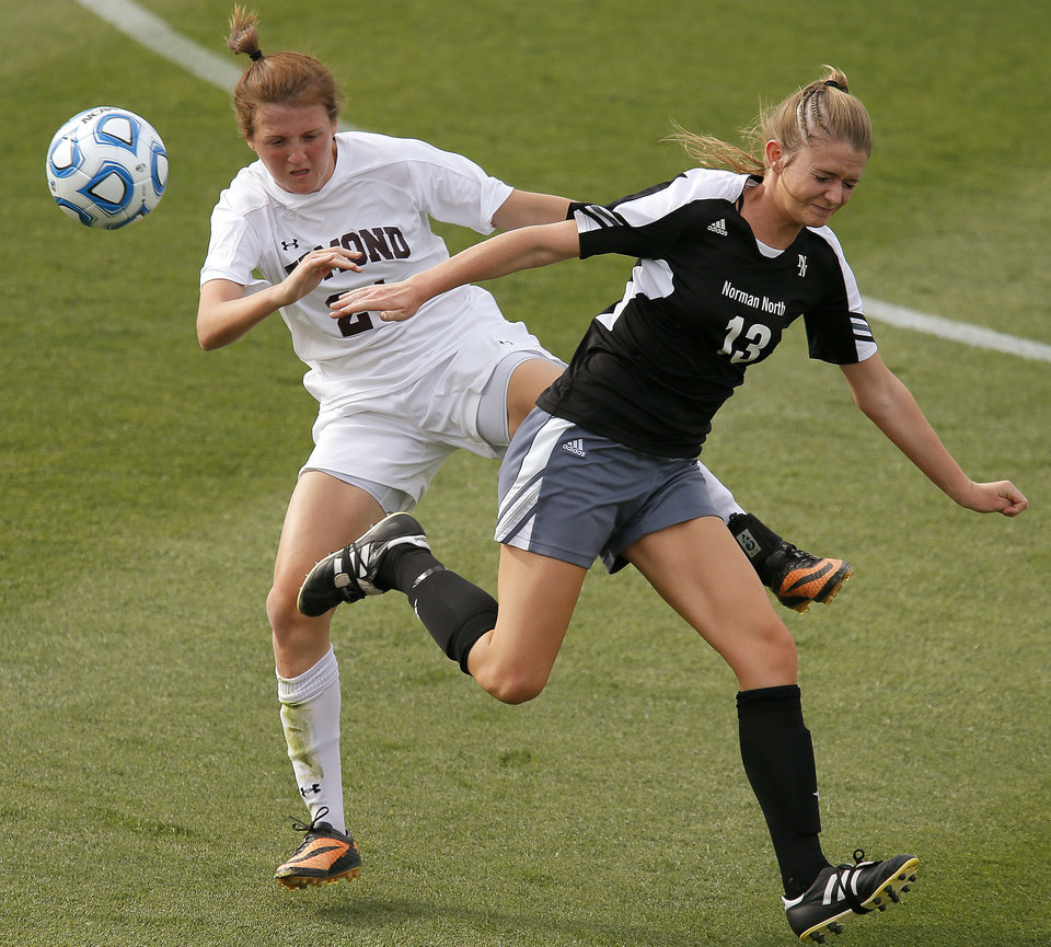 Photo - Edmond Memorial's Reagan Ballard, left, and Kristen Wilpitz fight for the ball during the Class 6A girls soccer championship between Edmond Memorial and Norman North in Norman, Okla., Friday, May 16, 2014. Photo by Bryan Terry, The Oklahoman
