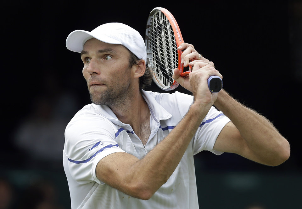 Photo - Ivo Karlovic of Croatia prepares to return to John Isner of the USA during a quarterfinal match at the Hall of Fame Tennis Championships in Newport, R.I. Friday, July 12, 2013. Isner won 7-6 (3), 7-6 (3). (AP Photo/Elise Amendola)