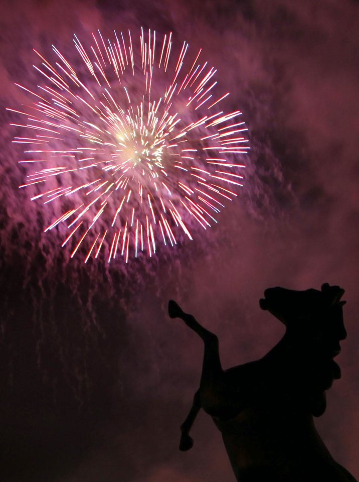 Fireworks explode behind a broncho statue during the LibertyFest fireworks show at the University of Central Oklahoma, Sunday, July 4, 2010, in Edmond, Okla. Photo by Sarah Phipps, The Oklahoman