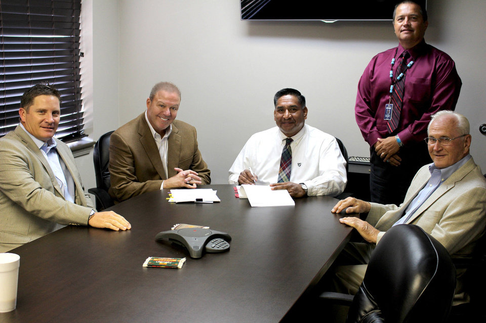 Photo - (from left) Curtis Branch, Rex's Chicken master franchisee for Oklahoma; David Rutkauskas, Beautiful Brands and Rex's Chicken CEO; Roger Barnett, Second Chief of the Muscogee Creek Nation; Woody Anderson, CEO of the Muscogee Nation Business Enterprise; and Otto Rutkauskas, CFO of Beautiful Brands.    - PROVIDED