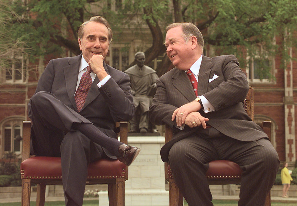 Photo - Former Sen. Bob Dole and OU president David Boren visit on the North oval before Dole speaks. *****Must type JAC for Jaconna Aguirre****