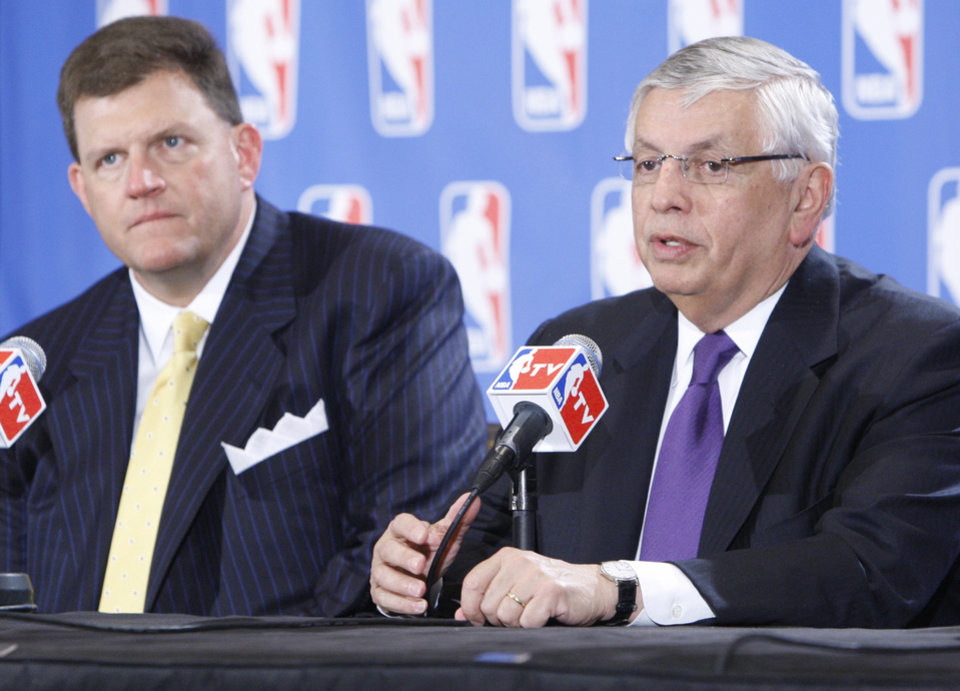 Photo - CLAYTON I. BENNETT, CLAYTON BENNETT, SEATTLE SONICS, NBA BASKETBALL: David Stern, right, commissioner of the NBA, speaks at a news conference in Oklahoma City, Tuesday, March 25, 2008, following a presentation by the city to the NBA relocation committee. Clay Bennett, left, owner of the Seattle SuperSonics, looks on  at left. (AP Photo) ORG XMIT: OKSO104