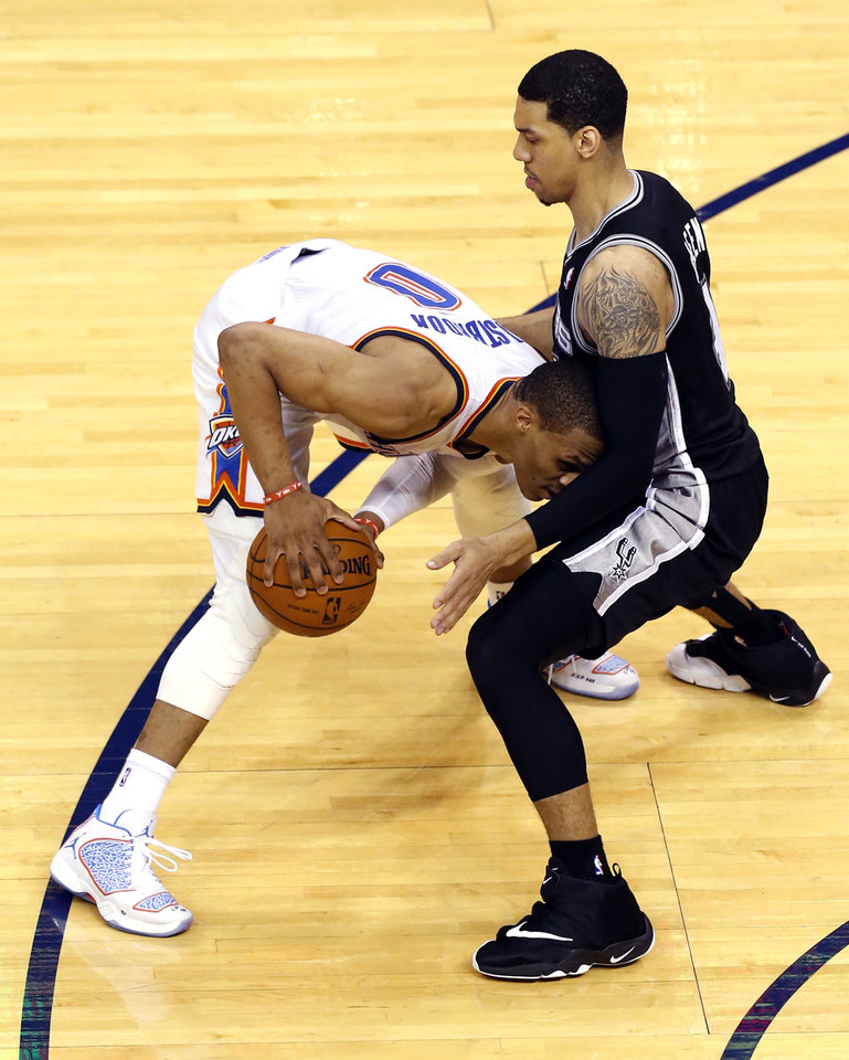 Photo - Oklahoma City's Russell Westbrook (0) tries to get by San Antonio's Danny Green (4) during Game 3 of the Western Conference Finals in the NBA playoffs between the Oklahoma City Thunder and the San Antonio Spurs at Chesapeake Energy Arena in Oklahoma City, Sunday, May 25, 2014. Photo by Bryan Terry, The Oklahoman