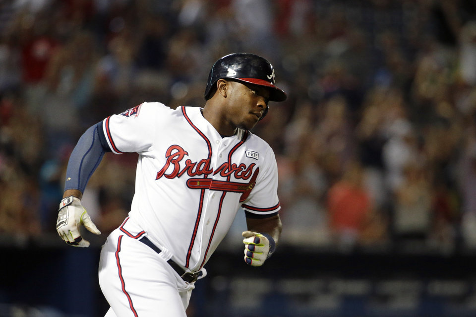 Photo - Atlanta Braves' Justin Upton rounds the bases after hitting a two-run home run to score teammate Freddie Freeman in the sixth inning of a baseball game against the Miami Marlins, Friday, Aug. 29, 2014, in Atlanta. (AP Photo/David Goldman)