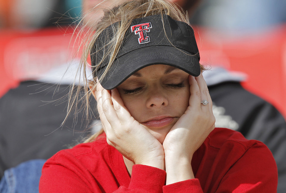 A Texas Tech fan reacts in the Red Raiders 66-6 loss to Oklahoma State during the college football game between the Oklahoma State University Cowboys (OSU) and Texas Tech University Red Raiders (TTU) at Jones AT&T Stadium on Saturday, Nov. 12, 2011. in Lubbock, Texas. Photo by Chris Landsberger, The Oklahoman ORG XMIT: KOD