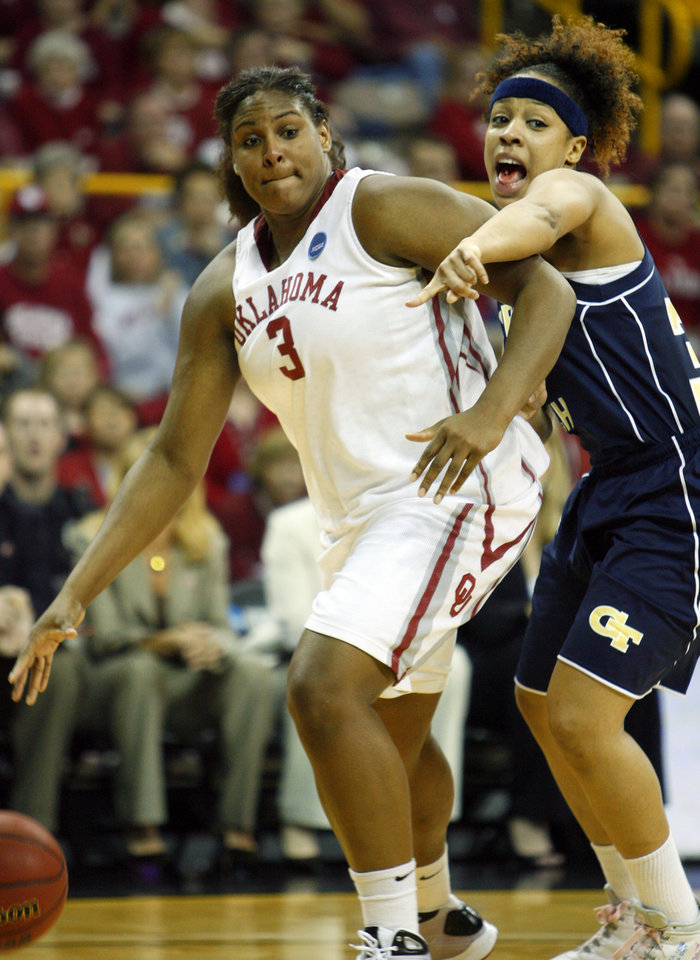 Photo - NCAA TOURNAMENT / WOMEN'S COLLEGE BASKETBALL: Courtney Paris goes to the basket around Iasia Hemingway in the second half as the University of Oklahoma (OU) plays Georgia Tech in round two of the 2009 NCAA Division I Women's Basketball Tournament at Carver-Hawkeye Arena at the University of Iowa in Iowa City, IA on Tuesday, March 24, 2009.   PHOTO BY STEVE SISNEY, THE OKLAHOMAN ORG XMIT: KOD