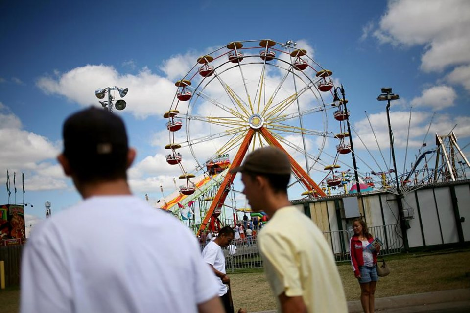 Photo -  Visitors to the fair walk the midway at the Oklahoma State Fair in Oklahoma City, Sept. 26, 2010. Photo by John Clanton, The Oklahoman