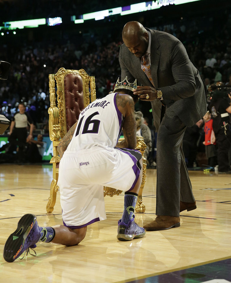 Photo - Ben McLemore of the Sacramento Kings receives a crown after dunking the ball over former NBA player Shaquille O'Neal during the skills competition at the NBA All Star basketball game, Saturday, Feb. 15, 2014, in New Orleans. (AP Photo/Gerald Herbert)