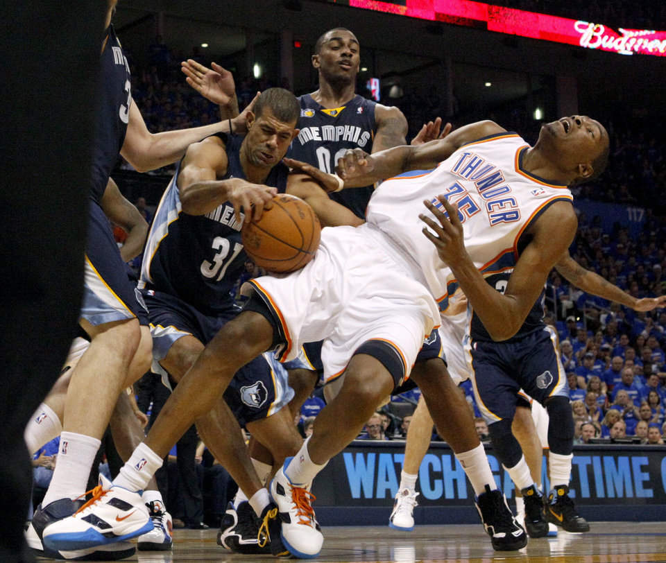 Photo - Oklahoma City's Kevin Durant (35) runs into Shane Battier (31) of Memphis and Darrell Arthur (00) during game two of the Western Conference semifinals between the Memphis Grizzlies and the Oklahoma City Thunder in the NBA basketball playoffs at Oklahoma City Arena in Oklahoma City, Tuesday, May 3, 2011. Photo by Bryan Terry, The Oklahoman
