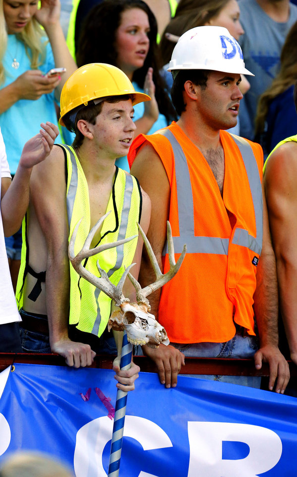 Deer Creek fans are dressed in construction gear during a high school football game between the Carl Albert Titans and the Deer Creek Antlers on Friday, Sept. 27, 2013 in Midwest City, Okla. Photo by Steve Sisney, The Oklahoman