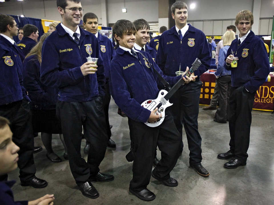 A crowd begins to gather as Meeker FFA student Shane Morrow play the game Guitar Hero during the FFA state convention at the Cox Convention Center on Wednesday April 29, 2009, in Oklahoma City, Okla.  Photo by Chris Landsberger, The Oklahoman