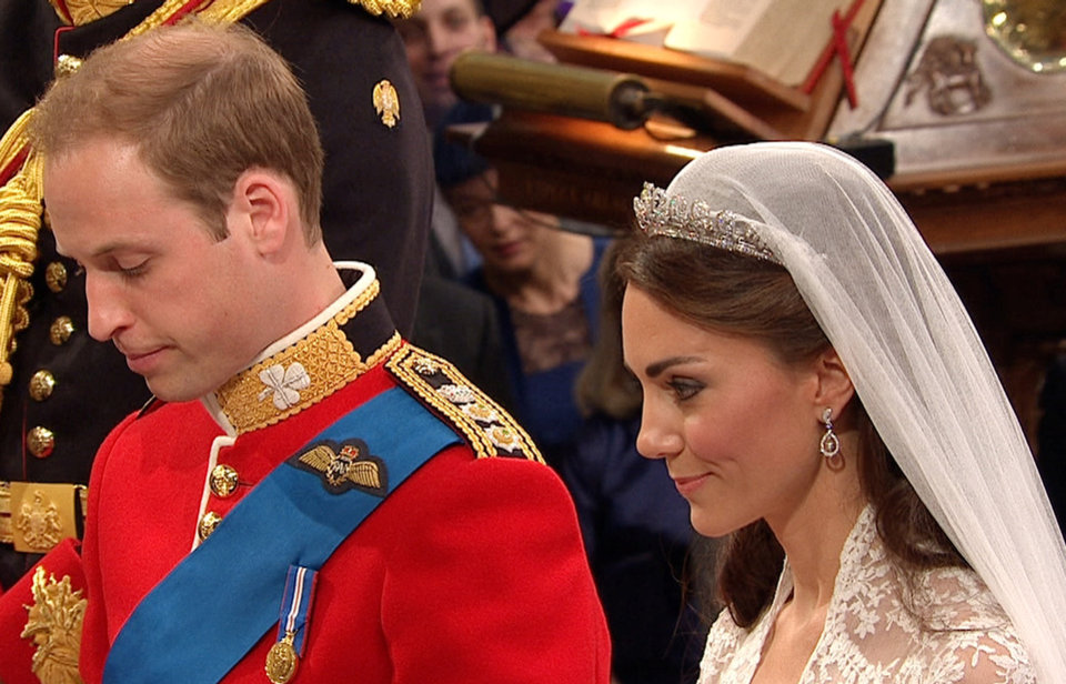 Photo - In this image taken from video, Britain's Prince William, left, stands at the altar with his wife, Kate, the Dutchess of Cambridge, at Westminster Abbey for the Royal Wedding in London on Friday, April, 29, 2011. (AP Photo/APTN) EDITORIAL USE ONLY NO ARCHIVE PHOTO TO BE USED SOLELY TO ILLUSTRATE NEWS REPORTING OR COMMENTARY ON THE FACTS OR EVENTS DEPICTED IN THIS IMAGE ORG XMIT: RWVM178
