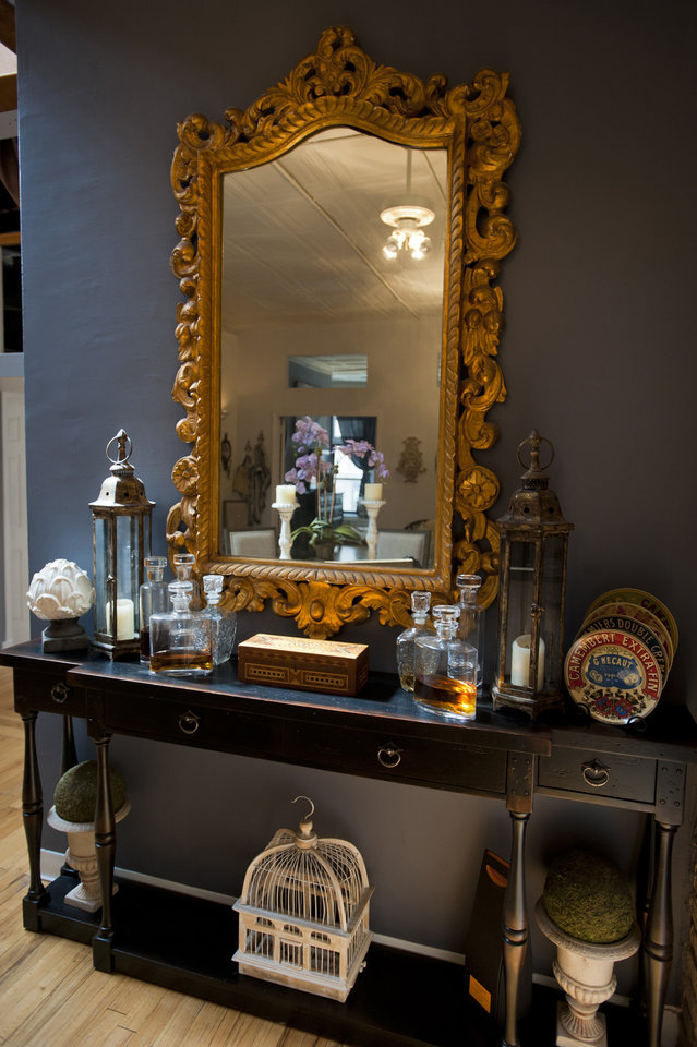 The bar, with a favorite gold mirror in the place, purchased from a Williamsburg (NY) antique shop is featured in Christian Siriano's New York City apartment, September 11, 2012. (Karl Merton Ferron/Baltimore Sun/MCT)