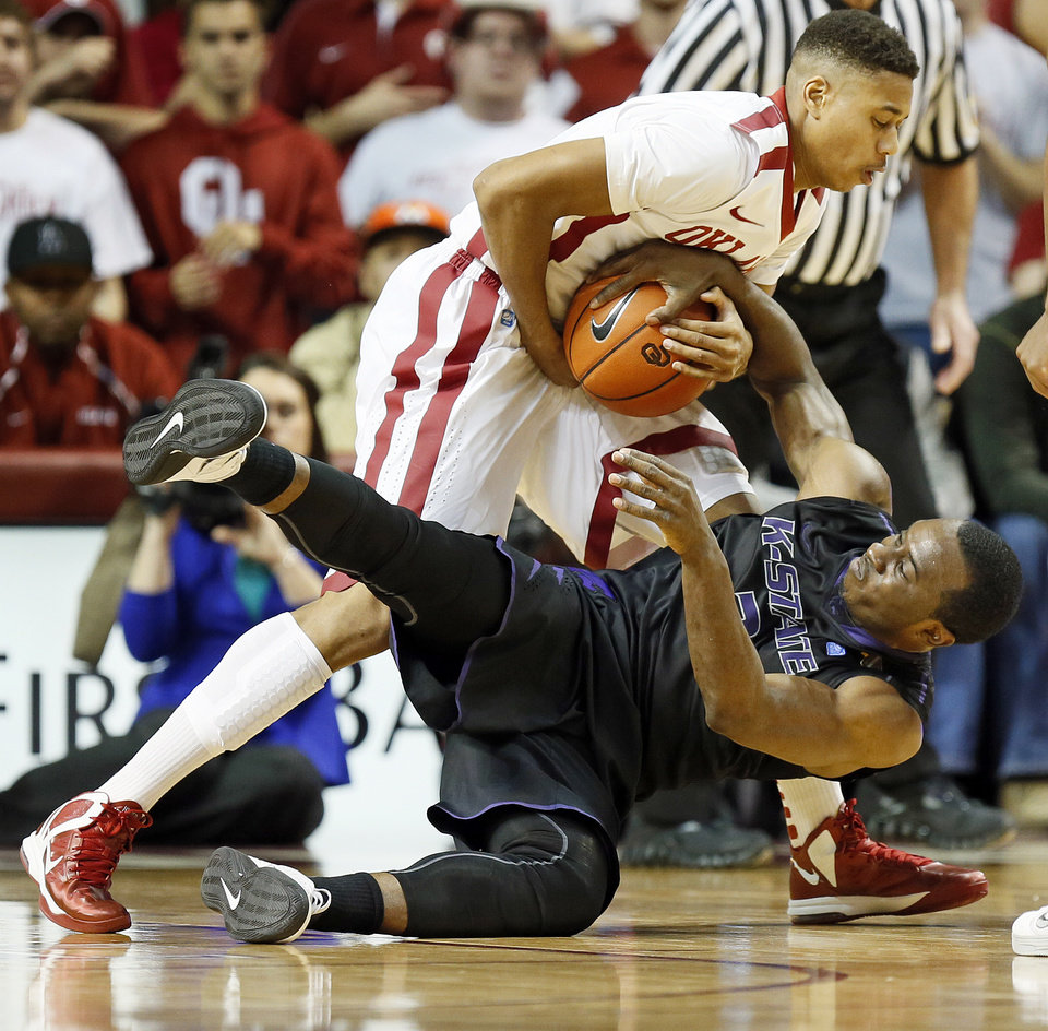 Photo - Oklahoma's Isaiah Cousins (11) and Kansas State's Martavious Irving (3) tie up the ball during an NCAA men's basketball game between the University of Oklahoma (OU) and Kansas State at the Lloyd Noble Center in Norman, Okla., Saturday, Feb. 2, 2013. Kansas State won, 52-50. Photo by Nate Billings, The Oklahoman