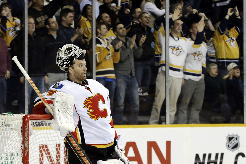 Calgary Flames goalie Miikka Kiprusoff, of Finland, waits for a goal scored by Nashville Predators' Nick Spaling, not shown, to be reviewed in the second period of an NHL hockey game, Thursday, March 21, 2013, in Nashville, Tenn. The goal was allowed. (AP Photo/Mark Humphrey)