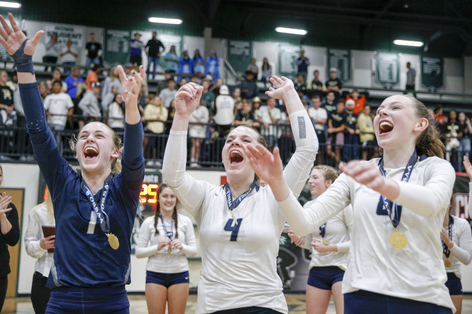 Photo - Edmond North's Gracie Burleson, Sarah Holmes, and Kamryn Bacus celebrate after defeating Broken Arrow 3-1 to win the OSSAA class 6A volleyball state championship at Catoosa High School on Tuesday, Oct. 22, 2019. IAN MAULE/Tulsa World