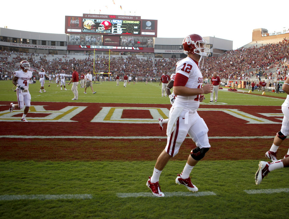Oklahoma\'s Landry Jones (12) jogs off the field prior to a college football game between the University of Oklahoma (OU) and Florida State (FSU) at Doak Campbell Stadium in Tallahassee, Fla., Saturday, Sept. 17, 2011. Photo by Bryan Terry, The Oklahoman